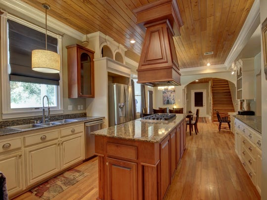 The kitchen is large with soothing colors and wood floors.