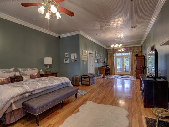 The huge master suite has offers views of the gorgeous outdoor property.