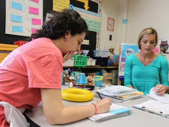 ESL goal clarity coach Kelly Bankes, left, works with Rebecca Zena, a classroom teacher fifth grade at Slaughter Elementary.April 1, 2016
