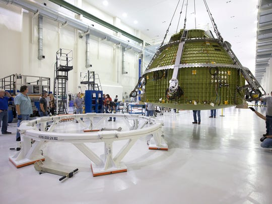 On April 21, the Orion crew module pressure vessel for NASA's Exploration Mission 1 was moved by crane along the high bay inside the Neil Armstrong Operations and Checkout Building at Kennedy Space Center. The crew module will be transferred to a proof pressure cell in the high bay for pressure checks.