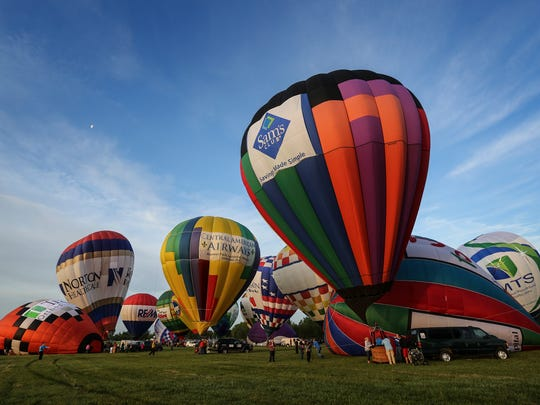 Balloons prepare to take to the skies before the start of the U.S. Bank great balloon rush hour race.