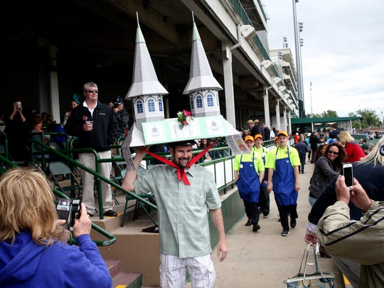 Chris Lowber was about to get tweeted out from Churchill Downs as race fans got a shot of his twin-spires hat.