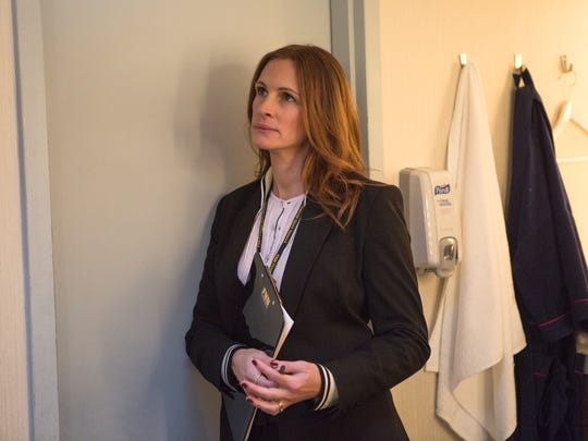 """Producer Patty Fenn (Julia Roberts) tries to keep her boss alive in """"Money Monster."""""""