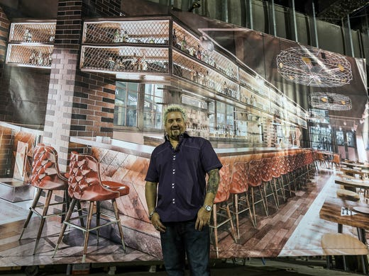 Guy Fieri Poses In Front Of A Rendering S