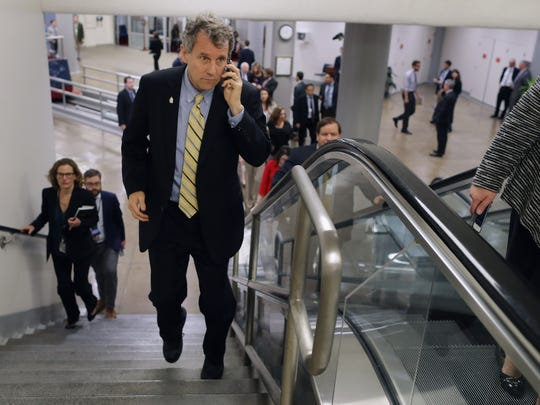 Sen. Sherrod Brown, D-Ohio, talks on his mobile phone while heading to the weekly Senate Democratic policy luncheon at the U.S. Capitol May 17, 2016, in Washington, DC.