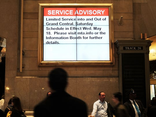 A service announcement on a monitor screen alerts travelers