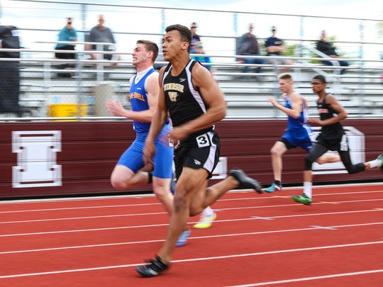 Michael Palmer from Maine-Endwell battles Dante Kimbrough from Windsor in the 100-meter dash trials Thursday.
