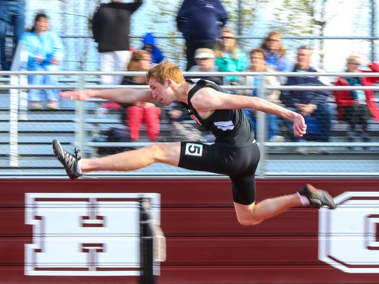 Union-Endicott's Tyler Hubeny clears a hurdle on his way to the STAC boys 110-meter high hurdles crown.