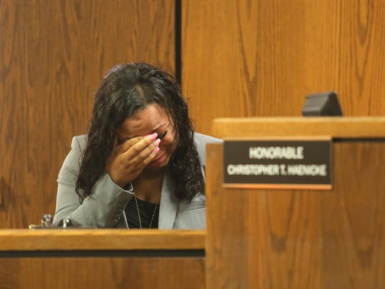 Witness and survivor Tiana Carruthers cries on the witness stand as Kalamazoo County Deputies remove defendant Jason Dalton after an outburst during his preliminary examination in district court on Friday. Prosecutors say Dalton gunned down six people and wounded two others in the Kalamazoo area over several hours on Feb. 20 while driving for Uber that night.