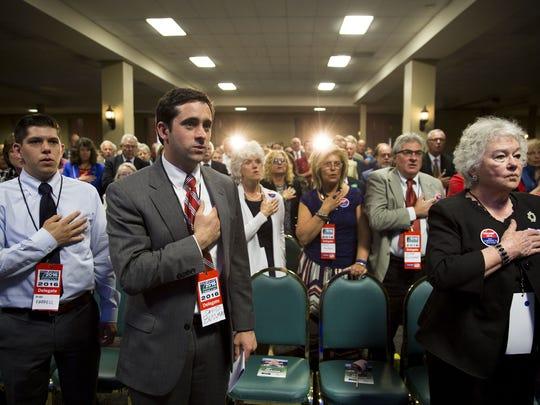 Vermont Republican delegates say the Pledge of Allegiance at the Vermont Republican Convention in South Burlington on Saturday.
