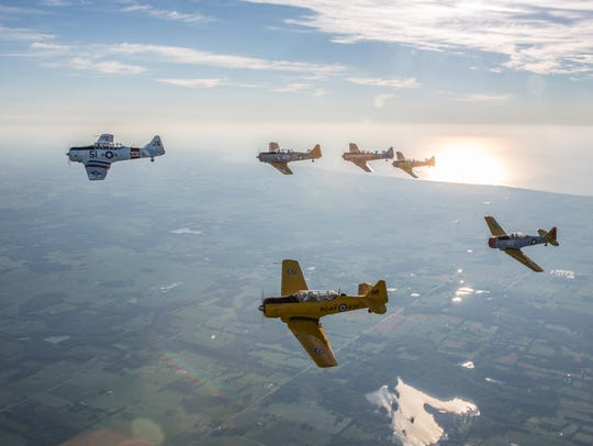 T6 aircraft in formation early Monday morning Warbirds