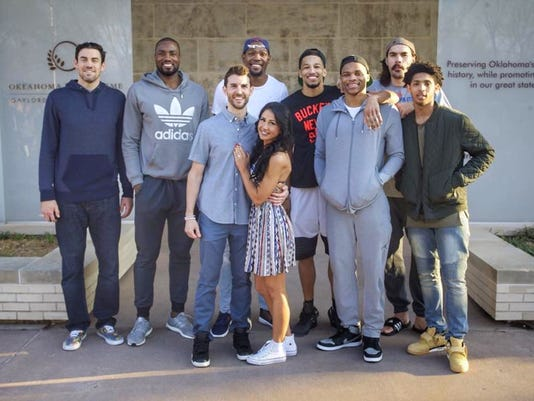 Thunder players with team operations manager