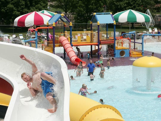 Gavyn Mills, then 14, goes down a slide at the Lake Park Aquatic Center in this Tribune file photo. The Board of Park Commissioners has announced that the pool will be closed in 2020 for considerations of finances, safety and health relating to the COVID-19 pandemic.