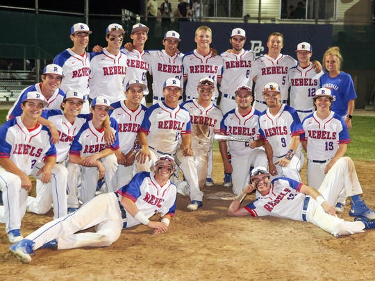 The Roncalli baseball team poses after defeating Pendleton Heights in a Class 4A regional final at Decatur Central.