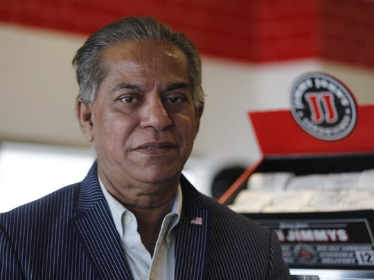 S. Ahmed Merchant stands at his Jimmy John's Gourmet