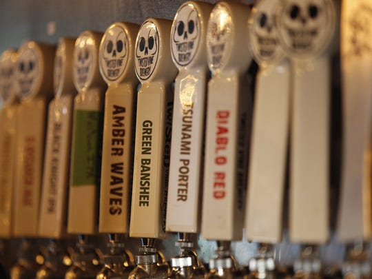 Various beers on tap line up at the new Twisted Vine