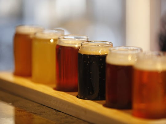 A personalized flight of beers is ready at the new