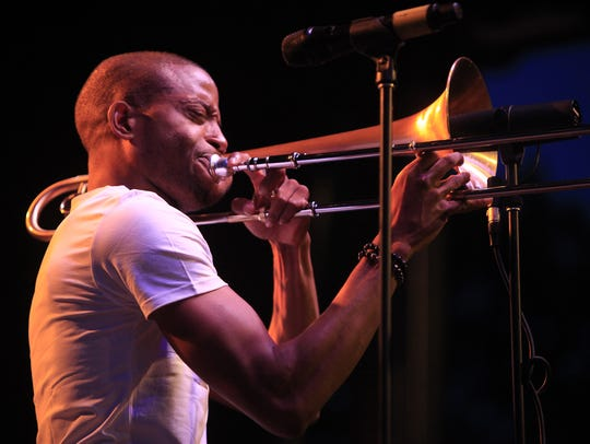 It poured during Trombone Shorty's outdoor jazz fest