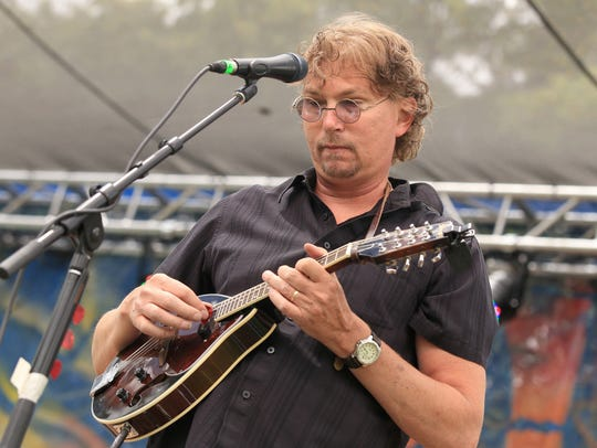 Brian Hoover plays a mandolin during a Bottled Monkey