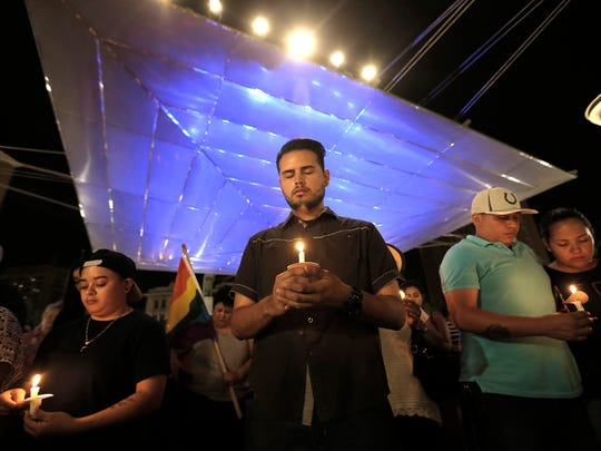 Hundreds of El Pasoans attend a candlelight vigil in honor of the fifty people in Orlando killed at the Pulse nightclub early Sunday morning.