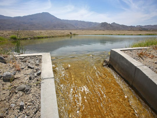 Water flows from one percolation pond to another as it recharges the aquifer at the Coachella Valley Water District's Thomas E. Levy Groundwater Replenishment Facility in La Quinta, June 8, 2016.