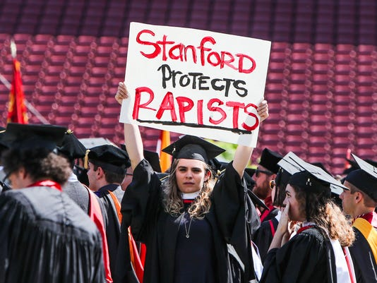 A Stanford graduate protests on June 12, 2016
