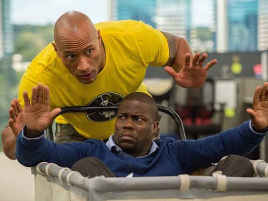 Kevin Hart, in cart, and Dwayne Johnson in 'Central