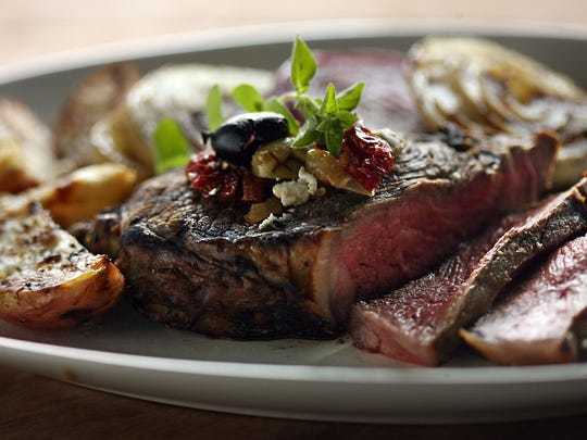 Grilled Strip Steak with Olives and Feta.