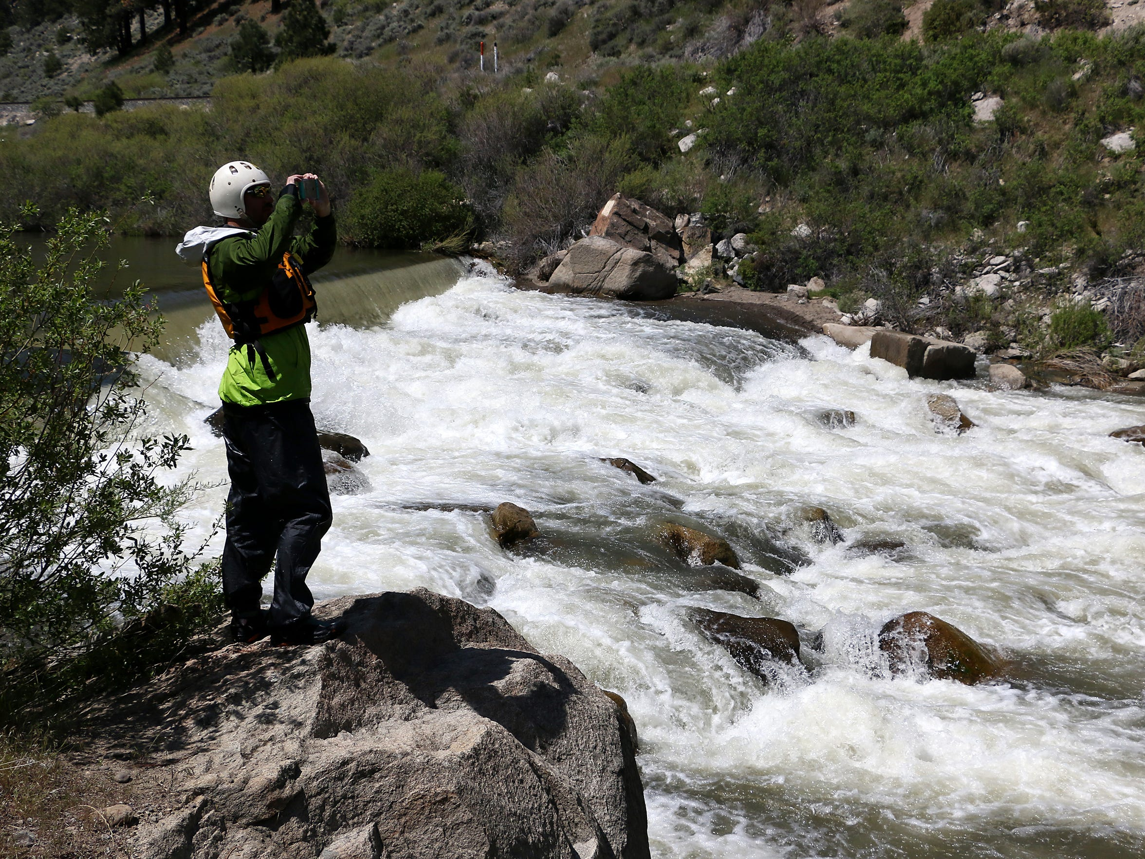 Scouting rapids on the Truckee River. RGJ reporters Ben Spillman and Jason Bean paddle the Truckee River from Truckee to Pyramid Lake during May of 2016.