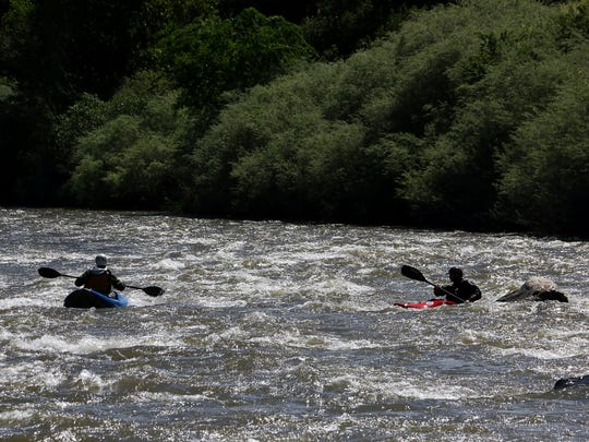 Paddlers Ben Spillman, left, and Noah Fraser navigate some class II rapids on the Truckee River in the Reno/Sparks area on May 13, 2016. RGJ reporters Ben Spillman and Jason Bean paddle the Truckee River from Truckee to Pyramid Lake during May of 2016.