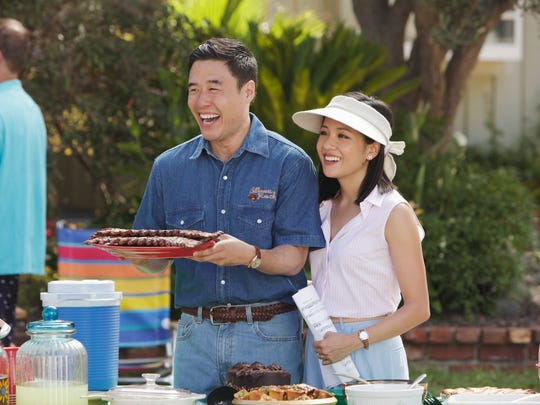 Louis Huang (Randall Park), left, and his wife, Jessica Huang (Constance Wu), have reason to be happy, as ABC Friday renewed their series, 'Fresh Off the Boat,' for a sixth season.