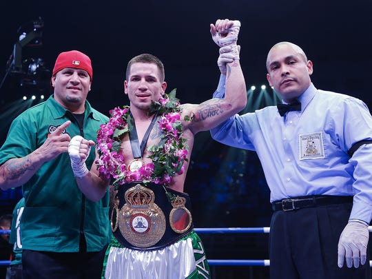 Camden's Jason Sosa celebrates his victory over Javier Fortuna of Dominican Republic during their WBA Mini Flyweight Eliminator boxing match at Capital Indoor Stadium on June 24 in Beijing, China.