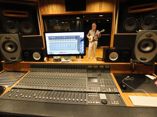 """Musician John """"Buddy"""" Winston stands in the recording room adjacent to Star City Studio's sound mix production room."""