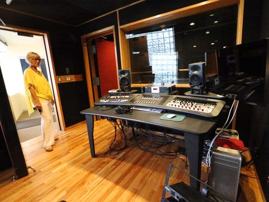 Pat Olchefski-Winston walks into a small recording studio designed for one or two people recording at a time.