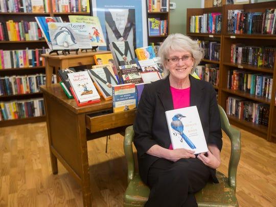 Alice Meyer, owner of Beaverdale Books, celebrates