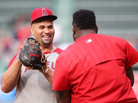 Albert Pujols of the Los Angeles Angels of Anaheim  talks to David Ortiz #34 of the Boston Red Sox before the game at Fenway Park on July 1, 2016 in Boston, Massachusetts.  (Photo by Adam Glanzman/Getty Images)