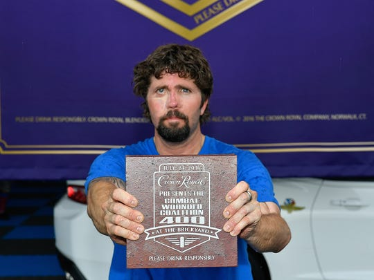 """SUFFOLK, VA - JULY 06:  Jason Redman celebrates after being named the winner of Crown Royal's """"Your Hero's Name Here"""" program during his 100th skydiving jump at Skydive Suffolk on July 6, 2016 in Suffolk, Virginia.  (Photo by Larry French/Getty Images for Crown Royal)"""