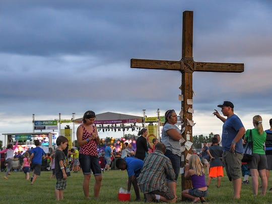 People put prayers on a wooden cross. Lifest 2016 kicked off Thursday at the Sunnyview Expo Center. The Christian music festival is the largest in Wisconsin.