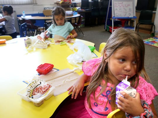 Alexia Lames enjoys milk while having lunch during the Begindergarten program at Green Valley Elementary. July 7, 2016
