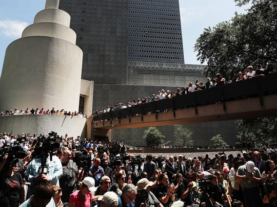 People gather in a prayer vigil in Dallas, Texas, last week after the shooting deaths of five police officers.