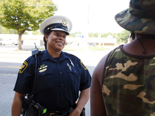 Officer Jennett Vaughn talks with Avondale residents as part of her work in community-oriented policing.