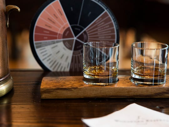 A sample is poured in the tasting room at the Woodford Reserve Distillery.  Sample sizes are due to increase thanks to recently passed legislation.