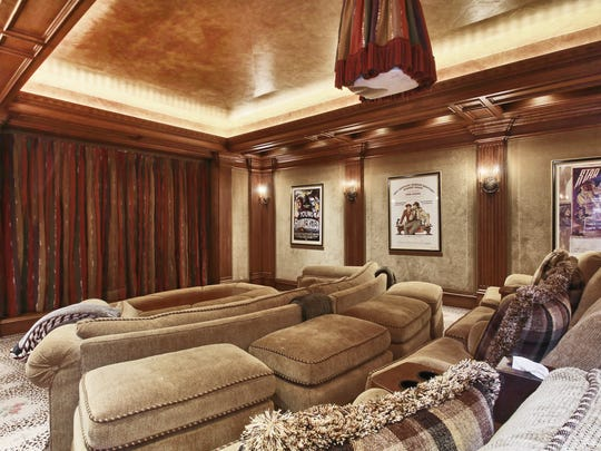 The 14-seat movie theater in this home is both ornate and comfortable.