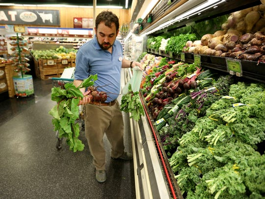 Ben Klopf, animal care manager, shops for produce at Sprouts in La Quinta during a morning of meal preparation for animals at the Living Desert Zoo on Wednesday, July 13, 2016.