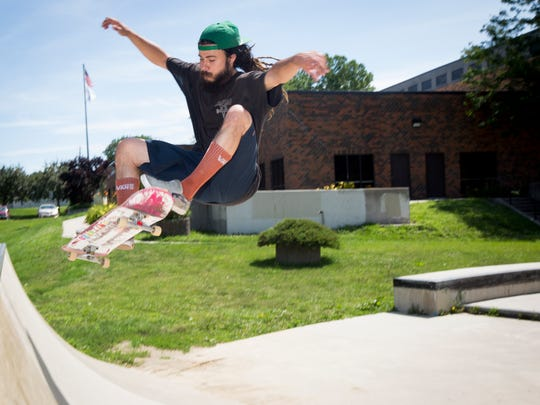 Kyle Jordan of Des Moines, practices skateboarding at the Robert L. Scott Four Mile Community Center, Thursday, July 14, 2016. He said he and friend Mirza Jasarovic, not pictured, skate up to five hours a day, unless they travel somewhere to skate, in which case, it's more. They hope to see a larger skate park in downtown Des Moines become a reality.