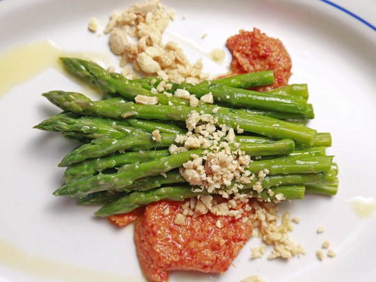 Side dishes include chilled asparagus with chunky romesco and ground almonds.