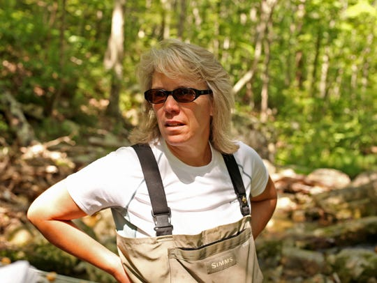 Dr. Christine May works with students during a stream