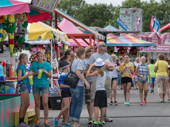 Crowds fill the midway at the Winnebago County Fair