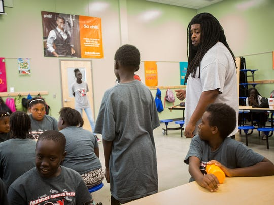 Stephen Williams gives instructions to children at the after-school and summer progrom at Edmunds Elementary School in the Oak Ridge Neighborhood in Des Moines, Tuesday, July 26, 2016. Williams, who works there, was given a raise, which in turn caused him to be cut off from state childcare assistance he needed for his 4-year-old daughter, Jordin.