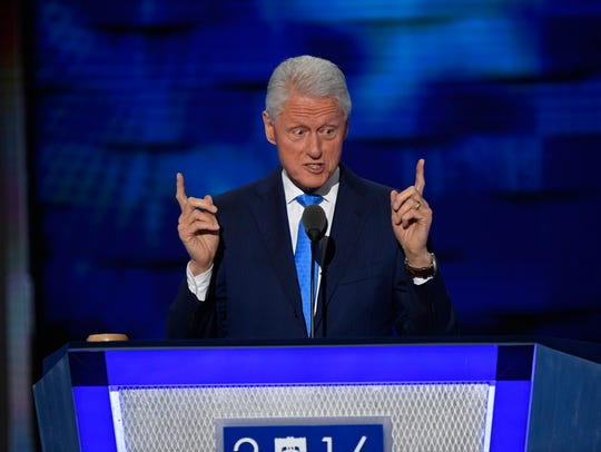 Former President Bill Clinton speaks on stage during